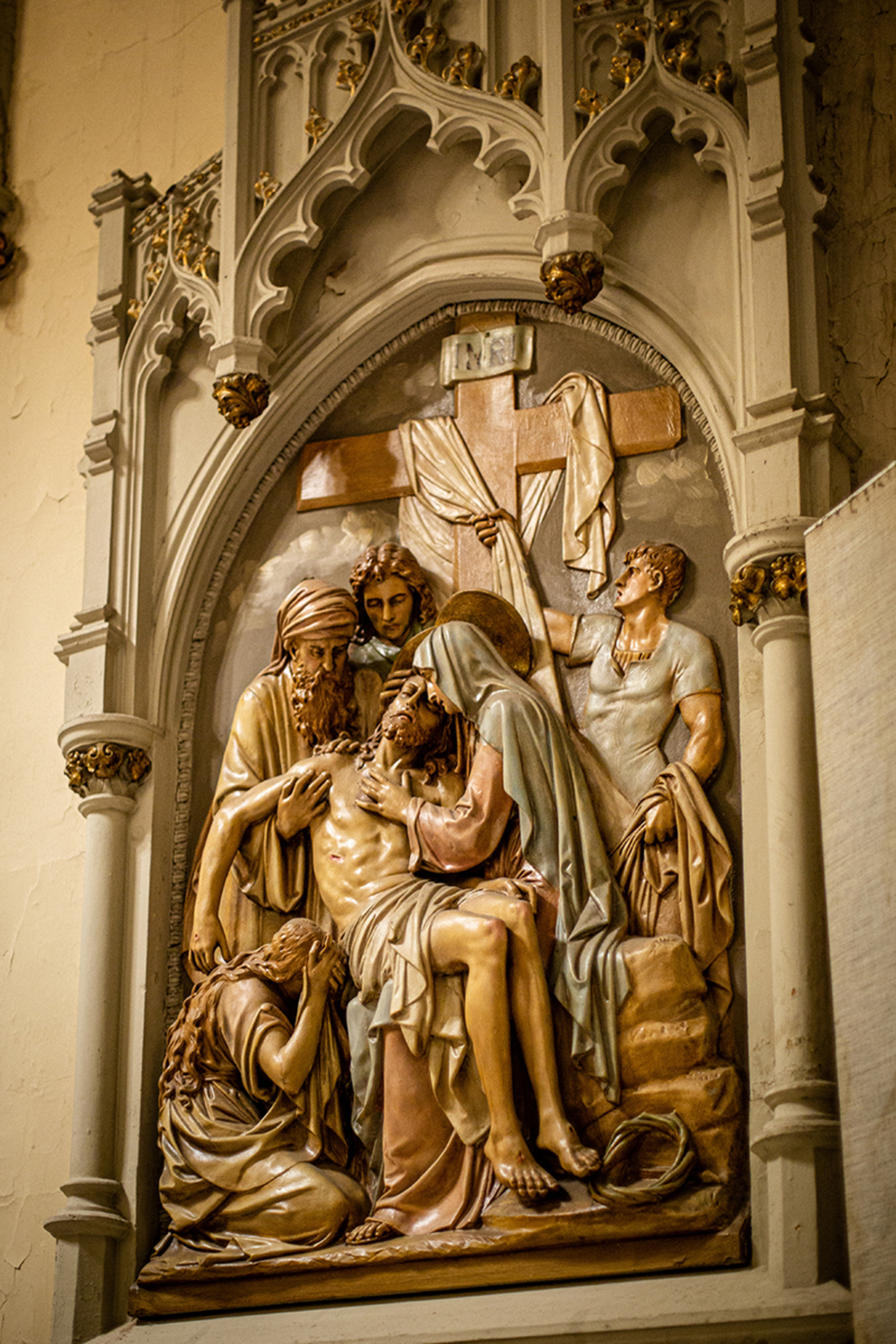 one of the stations of the cross at St. Augustine church in Brooklyn, NY